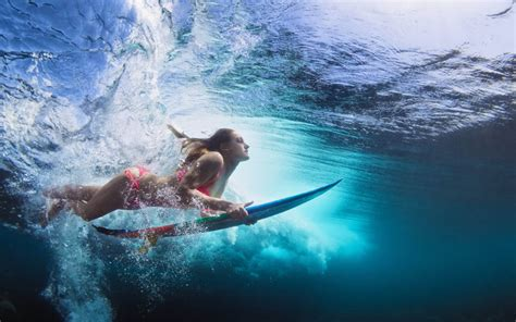 Surfer girl duck dive hawaii best beaches for surfing